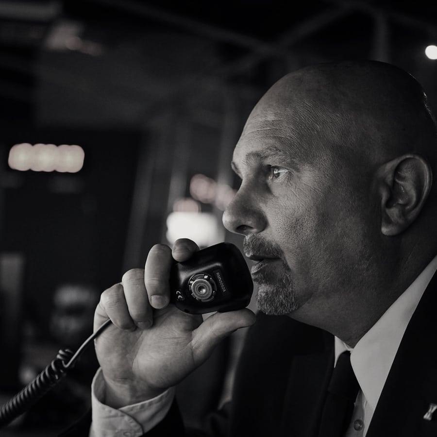 Avante Security guard holding a walkie talkie