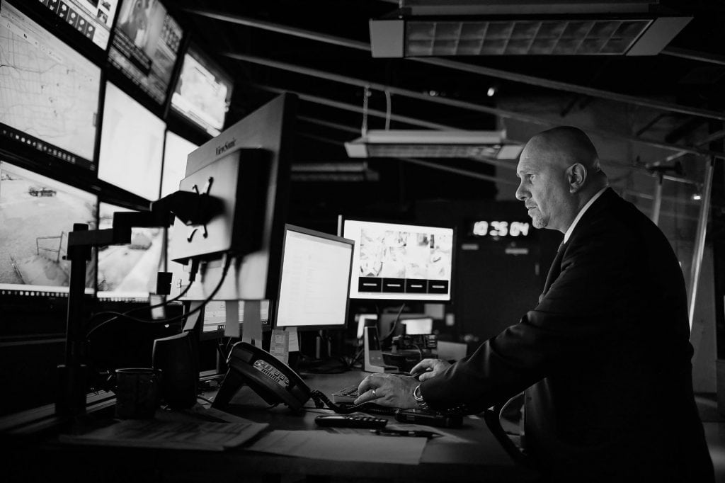 Avante Security operative accessing computer in Avante control centre