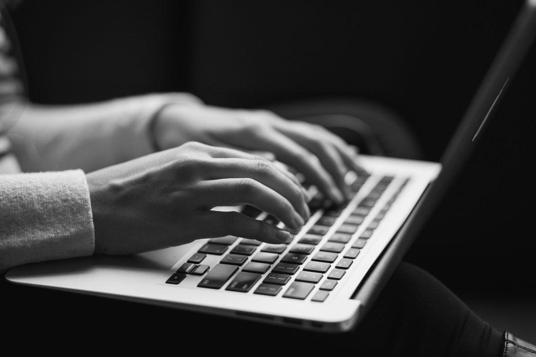 Hands on laptop keyboard.