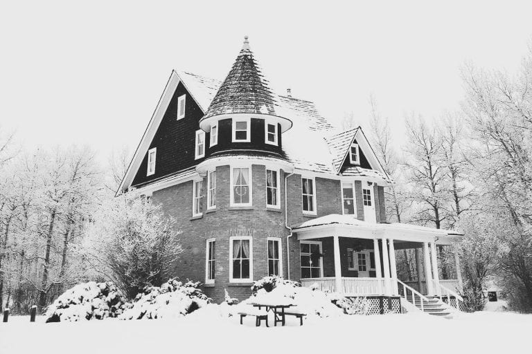 house covered in snow during winter