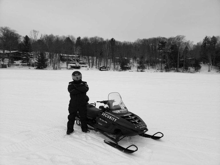 Avante Security guard with a snow mobile in Muskoka.
